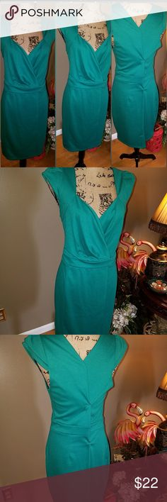 Gorgeous Teal Green FOREVER 21 Beautiful Forever 21 Teal Dress very slinky cut to your every curve. Dress is a 2X but fits like a 16. Forever 21 Dresses