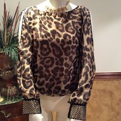 Blouse by ViviglamAdditional pics of it✂️✂️ Leopard blouse cut out in sleeves has gold studded wrist truly beautiful I post this a while ago but here r better pics for u u gonna love it like new ! Tops Blouses