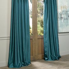 Dress up your window in extravagant style with this peacock blue, faux-silk curtain panel. Featuring a rich texture and vibrant color, this curtain panel makes a beautiful addition to a formal living