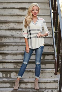 Pretty Little Things Plaid Top: Arrive to your next meeting in style with this must have Pretty Little Things Plaid top!  Full of class and comfort you'll want to wear it on the weekends too! Long Sleeve with ivory, black and red plaid design. TheChicFind.com