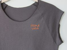 You're seeing the front view of the updated version of the Stone Yoga tee.  We really like the orange ink we used for the graphics on this shirt.