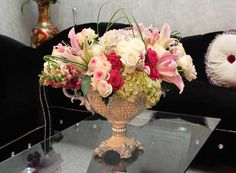 Flower carving table, look beautiful white roses and pink stargazer in classical vase