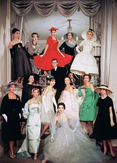 Yves Saint Laurent at Maison Dior surrounded by models wearing his designs, photo Sabine Weiss, 1958