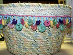 On a previous post  I introduced you to Barb who makes these fabulous Clothesline Wrapped baskets that are all over the Attic Window Quilt...