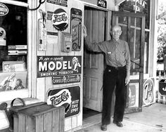 "Frank Gelston, 86, outside his general store in Elk City, Nebraska, in June 1949. Gelston and his wife, Mary, owned and operated the store since 1892 and sold dry goods, clothing, groceries, fresh meat, school equipment, medical supplies, hardware and cold soda pop. According to The World-Herald, Gelston and his wife still kept the store open six days a week. ""We don't open on Sunday any more,"" he said. ""Life's too short to work that hard."" THE WORLD-HERALD"