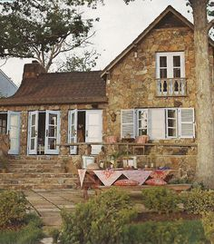 Adorable country house with pale blue shutters
