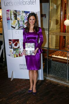 "Pippa Middelton catches attention in a purple dress as she launches her entertaining book in Holland. The socialite and royal sister was full of smiles as she showed off her book ""Celebrate: A Year of Festivities for Family and Friends."""