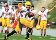 Palma's Marcus Washington runs in a touchdown against North County on... (DAVID ROYAL/The Herald)