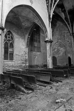 Broken Pews - Jonathon Much. The last remaining destroyed rows of pews sit in various stages of deconstruction at the Transfiguration church in Buffalo, New York.