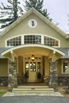 HOLY GORGEOUS!!!   Stone Veneer Columns featured on lake house by an architect from new hampshire