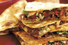 Cheese and spicy beef tortillas-(1lb 2oz) beef mince ½ tsp paprika 2 pinches cayenne pepper 1tsp sunflower oil 8 flour tortillas 200g (7oz) fresh tomato salsa 6 spring onions, sliced 200g (7oz) Cheddar cheese  Read more at http://www.goodtoknow.co.uk/recipes/137636/Cheese-and-spicy-beef-tortillas#ujmYB65wVAPqRkAV.99