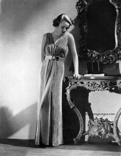 Long v-neck gown, gathered and cinched at waist with belt. Lord & Taylor 1935. From myvintagevogue.com