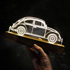 Luminária LED colecionável! Ilumine sua casa com um modelo exclusivo de luminária. Decore seu espaço com um modelo exclusivo de um dos carros mais clássicos e famosos de todos os tempos: o Fusca! Glass Art Design, Wood Design, Mood Light, Led Night Light, Lampe 3d, Laser Cut Lamps, Garden Cabins, Laser Cutter Ideas, Epoxy Resin Art