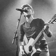 I love all these pictures of him with his guitar
