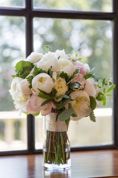 Hand-tied peony and rose summer bouquet in blush and white