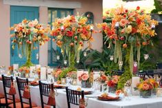 Love the orange, yellow and green in the floral arrangements - Rustic Fall Wedding at Rancho Valencia Resort Fall Wedding Centerpieces, Wedding Reception Decorations, Wedding Table, Orange Centerpieces, Table Decorations, Candelabra Centerpiece, Reception Table, Rustic Wedding, Summer Wedding Colors
