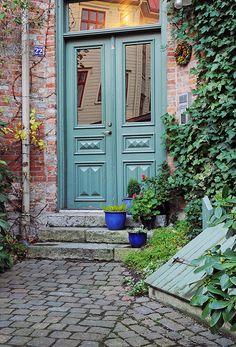 Colorful front door in brick house...