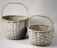 As depicted, in very good condition, with carved handles and in a soft gray-blue paint with dry patina. Dimensions: height to larger basket's handle, height to smaller basket's handle. Old Baskets, Vintage Baskets, Large Baskets, Baskets On Wall, Wall Basket, Egg Basket, Painted Baskets, Blue Gray Paint, Nantucket Baskets