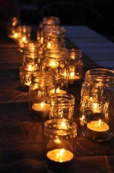 Tea light clusters in mismatched jars as step decoration. Minimal cost.