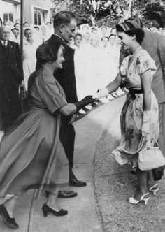 Lady Cooper is presented to Queen Elizabeth by State Library of Queensland, Australia, via Flickr
