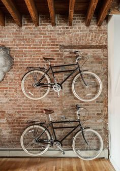 Wall-mounted bicycles alse serve as dramatic decorative pieces when set against a brick wall in the living room - Decoist