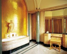 The opulence of the materials.  Eltham Palace, London The bathroom designed by Peter Malacrida. The vaulted ceiling, the precious marbles and niche covered with golden mosaic making it one of the most magnificent rooms of the house.