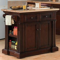 Malvern by Tresanti. $831.99. 2 Cabinet doors on each side with adjustable shelves. Decorative frame and panel sides and drawers. 2 Operable drawers with a pull through mechanism to allow access on either side. Features an adjustable/removable spice rack, utensil organizer and a cutting board. Top features a thick rubberwood work surface with a butcher block pattern. Malvern kitchen island in midnight cherry.