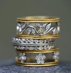 Cathy Waterman. The middle one, was my wedding ring that got stolen. :-(....