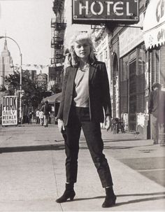 Debbie Harry on the Bowery where her old apartment used to be ... a block away from CBgBs  --- The Palace Hotel was for drunks and indigent men to sleep it off.