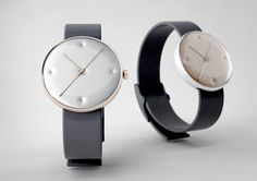 Designed by Studio Dreimann. Alloyed metal body with domed glass. Hand-made numbers comes with leather or rubber band.