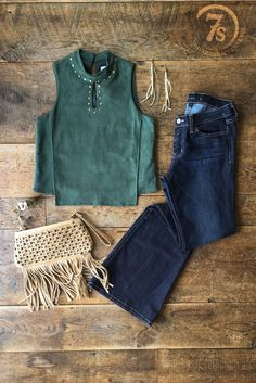 - Hunter green faux suede top - Brass studded detail around front and back neckline - Front longer panel that moves in a flattering way - Mock neck with double button closure at back of neck - Keyhole