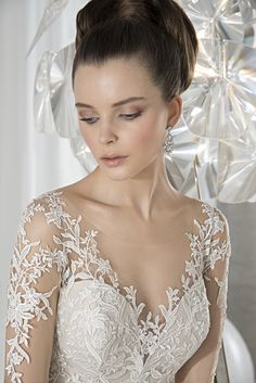 Illusion lace scoop neckline. #DemetriosBride Style 631.