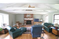 Family room with cathedral ceiling and exposed beams.