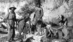 Nigerian soldiers of the 81st (West Africa) Division and Indian soldiers of the Indian XV Corps bathe in a stream during the Burma Campaign. May 1944.