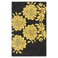Transform your den, dining room, or master suite into a  bohemian retreat with this beautiful rug, showcasing an exotic-inspired motif and artfully crafted detail.
