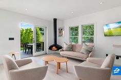 A sleek floating fireplace is a trendy alternative to the classic living room fireplace.