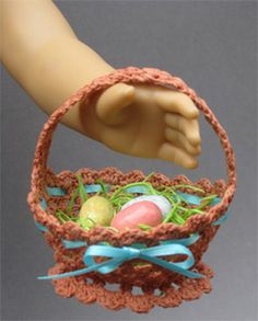 """Crocheted Easter Basket for American Girl Dolls ♦ Pattern from """"The Mary Frances Knitting and Crocheting Book 100th Anniversary Edition"""" by Classic Bookwrights. Made with Caron Simply Soft yarn. http://www.amazon.com/dp/1937564053/ Stiffen your basket with Stiffy Fabric Stiffener. Use an orange wrapped in plastic wrap for a mold, hang to dry overnight and remove orange after stiffener has dried."""