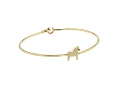 The solid gold Dala Horse bangle to bring strength and remind the wearer to 'Be strong'.