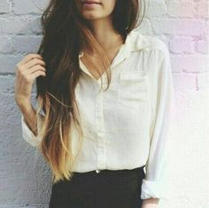 An indie look with long ombre hair and a flowing top tucked into dark jeans.