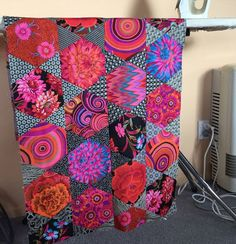A couple of weeks ago I decided it was time to revisit my Mediterranean Hexagons quilt from the Kaffe Fassett class I attended in January (you can read that blog post here). Kaffe and Brandon shared s