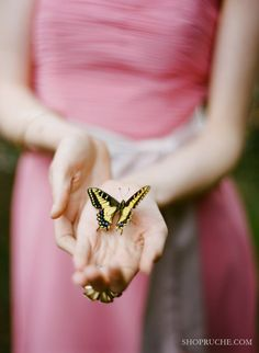 Holding a butterfly, that's not really me.