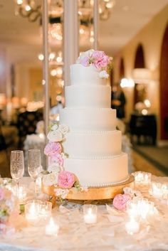 Cake with Blush %26 Vanilla Flowers    Photography: Arte de Vie   Read More:  http://www.insideweddings.com/weddings/modern-wedding-with-southern-traditions-in-new-orleans-louisiana/712/