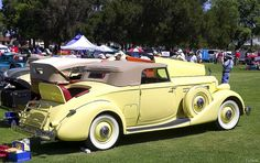 1935 Packard 1207 Convertible Coupe with top up - yellow
