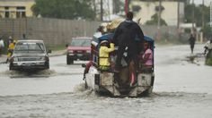 A truck used as public transportation drives through flooded streets in Port-au-Prince, Haiti's capital, on Tuesday, October 4, as Hurricane Matthew made landfall. The Category 4 storm was predicted to move near eastern Cuba and over portions of the Bahamas later Tuesday.