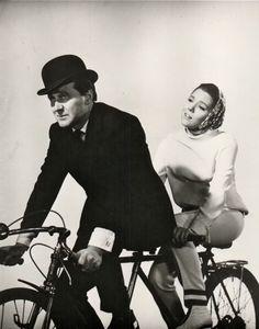 Patrick Macnee and Diana Rigg ride a bike