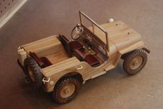This is a WWII era Military Jeep Model measuring approximately wide by long. The design is from Toys & Joys and includes a trailer (to be built later). Wooden Toy Cars, Wooden Truck, Diy Wood Projects, Wood Crafts, Woodworking Wood, Woodworking Projects, Toy Garage, Military Jeep, Wood Toys Plans