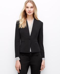 """The third piece: our new triacetate jacket matches a clean, collarless silhouette with a flared peplum back for covetable allure. Long sleeves with functional sleeve buttons for added styling options. One-button front. Front besom pockets. Peplum back. Lined. 21"""" long."""
