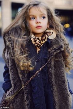 little small cute pretty girl long brown wavy curly hair leopard print shirt top blouse navy blue cardigan sweater clothes fur coat jack jacket anorak winter fall style kid kids