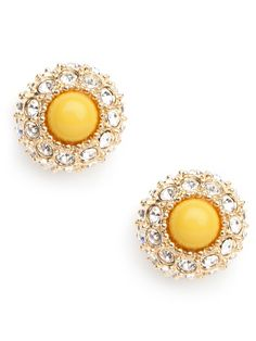 These striking studs take flower power up a gorgeous and glitzy notch. A yellow cabochon gemstone forms the center of this luxe sunflower while the surrounding sparkling crystals are—what else?—the petals.