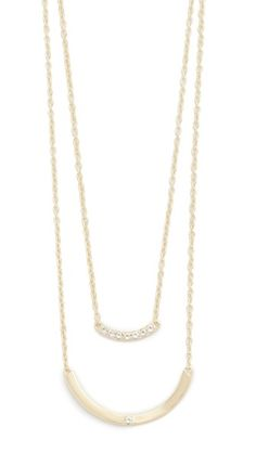 White topaz stones detail the curved bar pendant on this tiered Elizabeth and James necklace. Adjustable length and lobster-claw clasp.